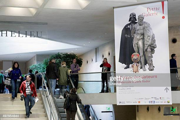 A poster of the exhibition 'Mythes Fondateurs D'Hercule a Dark Vador' is displayed at the Louvre museum on October 16 2015 in Paris France The...