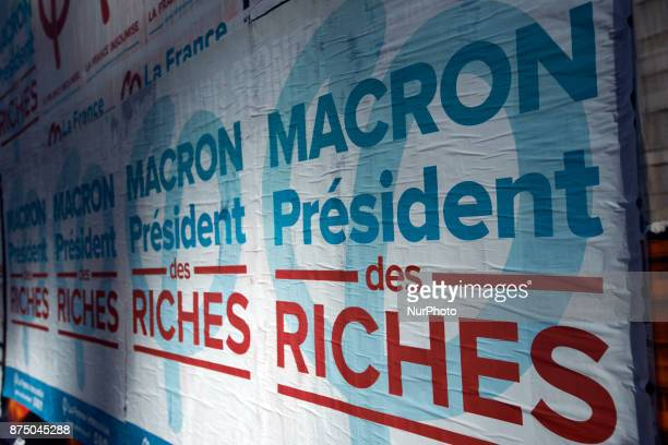 A poster of the 'France Insoumise' party on French President Macron reading 'Macron president of the wealthy' More than 4000 protesters took to the...