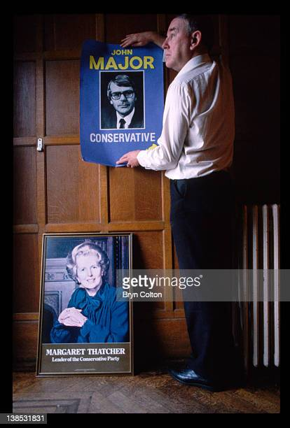 A poster of the new Prime Minister and Conservative party leader John Major replaces a poster of former Prime Minister and Tory leader Margaret...