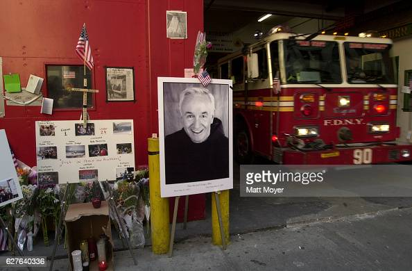 A poster of the Rev Mychal Judge New York's Fire Department chaplain is part of a memorial to victims of the World Trade Center attack outside of...