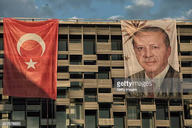 A poster of Turkey's President Recep Tayyip Erdogan hangs on Ataturk Cultural Center at Istanbul's central Taksim Square on July 18 2016 in Istanbul...