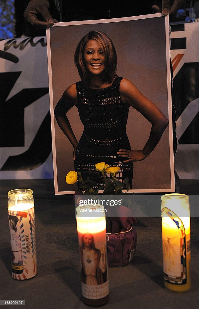 Poster of <a gi-track='captionPersonalityLinkClicked' href=/galleries/search?phrase=Whitney+Houston&family=editorial&specificpeople=201541 ng-click='$event.stopPropagation()'>Whitney Houston</a> with candles at <a gi-track='captionPersonalityLinkClicked' href=/galleries/search?phrase=Whitney+Houston&family=editorial&specificpeople=201541 ng-click='$event.stopPropagation()'>Whitney Houston</a> Leimert Park Vigil on February 13, 2012 in Los Angeles, California.