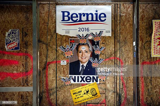 TOPSHOT A poster placed by supporters of Bernie Sanders compare Hillary Clinton to former US president Richard Nixon in protest against the DNC and...