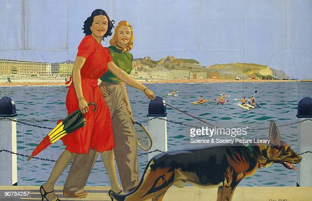 Poster produced for Southern Railway to promote rail travel to Hastings East Sussex The poster shows two smiling women walking a dog along the...