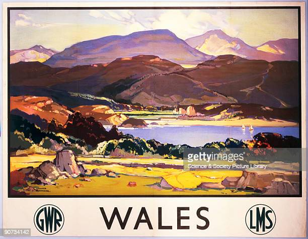 Poster produced for the Great Western Railway and London Midland Scottish Railway promoting rail travel to Wales showing a view of a lake in the...