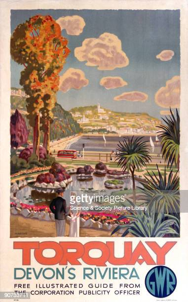 Poster produced for the Great Western Railway showing a view of the harbour at Torquay noted for its mild climate with a fashionablydressed couple...