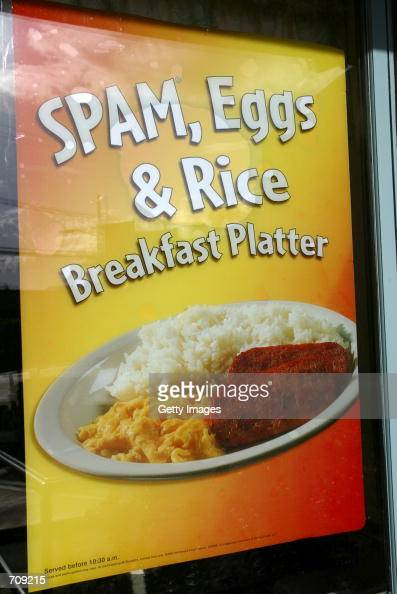 A poster promotes the new Spam Eggs and Rice Breakfast Platter at a McDonald's restaurant June 11 2002 in Haleiwa Hawaii The 78 McDonalds outlets in...