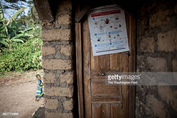 A poster promoting Ebola awareness on the door of a home in Meliandou Guinea on January 25 2015 Meliandou is considered the starting point of the...