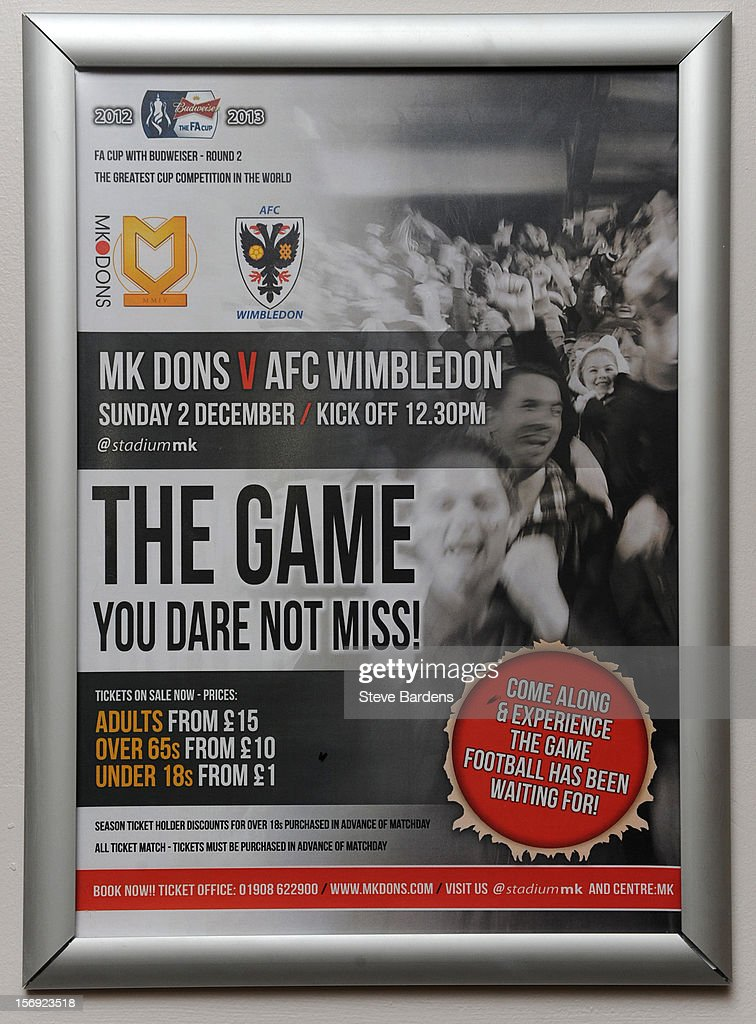 A poster promoting the upcoming FA cup match between MK Dons and AFC Wimbledon at Stadium MK on November 24, 2012 in Milton Keynes, England.