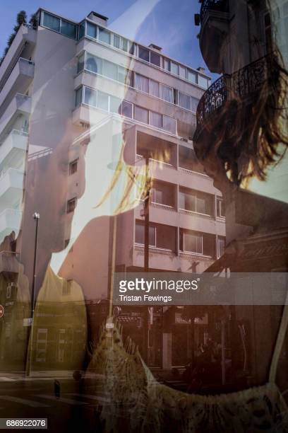 A poster reflects in a window during the 70th annual Cannes Film Festival at on May 22 2017 in Cannes France