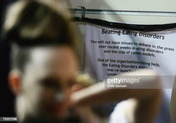 A poster relating to the recent model weight debate is dsiplayed backstage at the Ashley Isham fashion Autumn/ Winter 2007 show during London fashion...