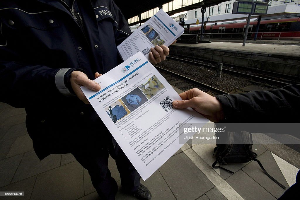 A poster released by the police shows the suspect of an attempted bomb attack at Bonn central train station on December 13, 2012 in Bonn, Germany. German police have begun searching for a second suspect they believe was behind a bomb scare in the western city of Bonn. The local police had expanded their search after spotting a potential suspect on video footage from a nearby fastfood restaurant.