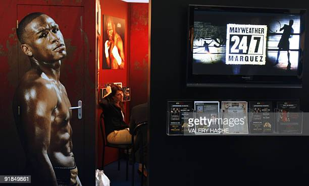 A poster representing US boxer Floyd Mayweather is displayed in the HBO Sports exhibition booth at the 20th edition of the International sports...