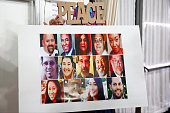 A poster showing all 14 victims is displayed during an interfaith memorial service at the Islamic Center of Redlands for the victims of the San...