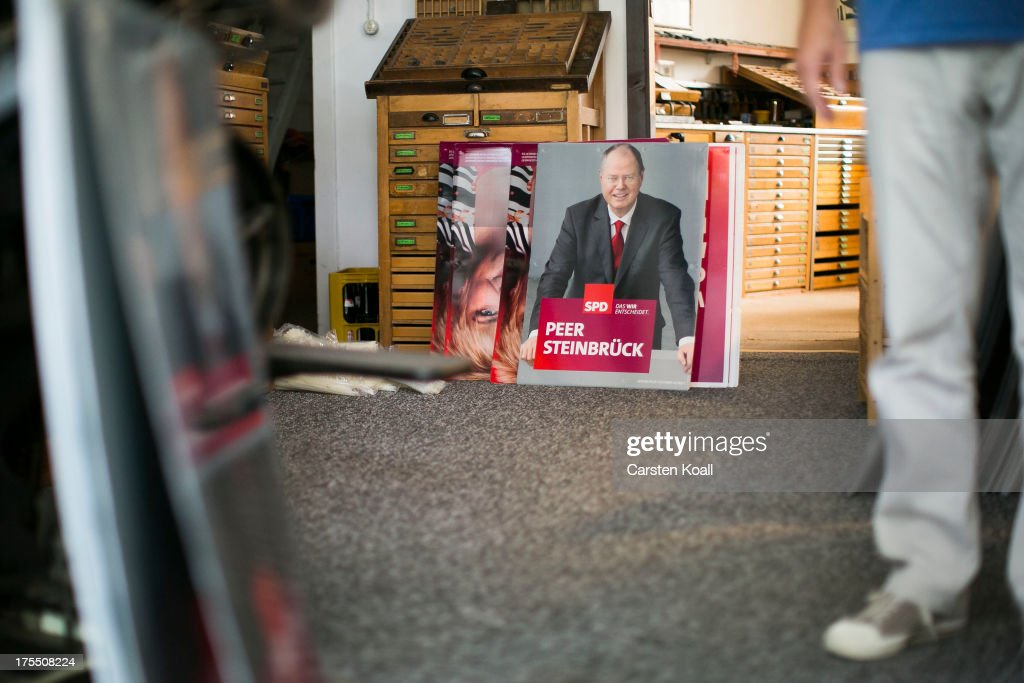 A poster showing German Social Democrats (SPD) chancellor candidate Peer Steinbrueck waits at the printers to be displayed for the election campaign on August 4, 2013 in Berlin, Germany. Germany is scheduled to hold federal elections on September 22 and so far current Chancellor Angela Merkel and her party, the German Christian Democrats (CDU), have a strong lead over the opposition.