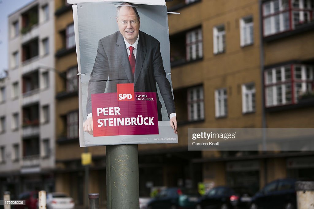A poster showing German Social Democrats (SPD) chancellor candidate Peer Steinbrueck hangs for the election campaign on August 4, 2013 in Berlin, Germany. Germany is scheduled to hold federal elections on September 22 and so far current Chancellor Angela Merkel and her party, the German Christian Democrats (CDU), have a strong lead over the opposition.