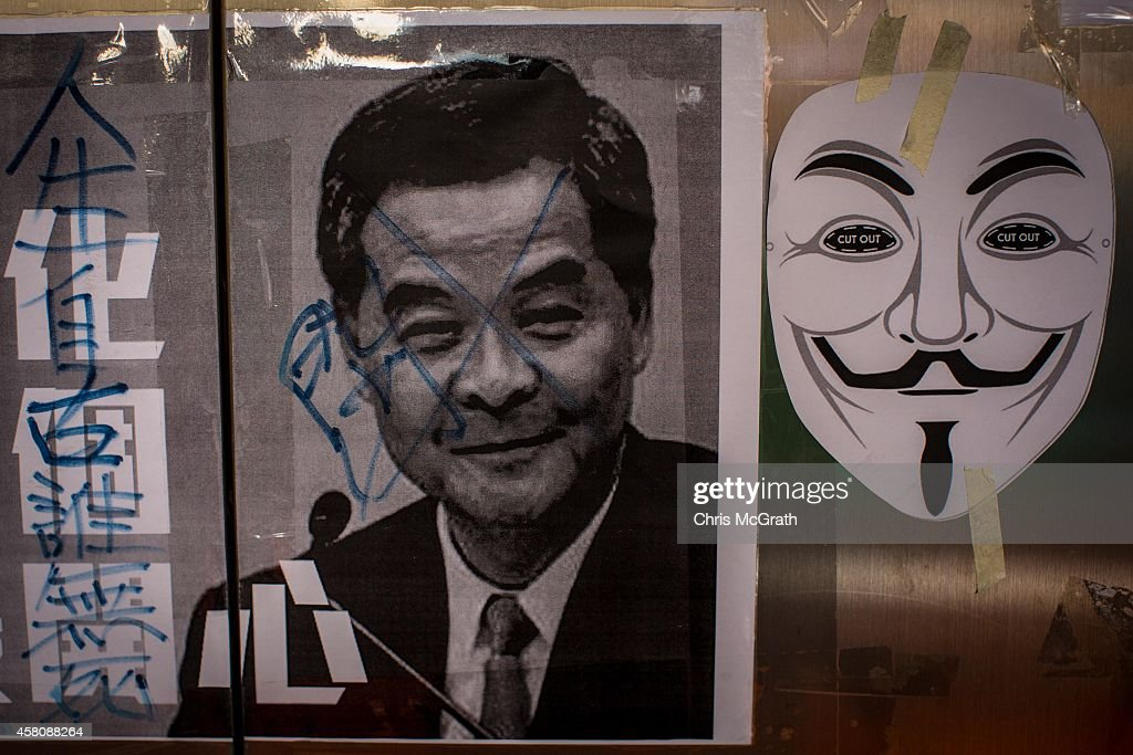 A poster showing Hong Kong's Chief Executive C.Y. Leung is seen on a wall at the Occupy Central protest site in the Admiralty District on October 29, 2014 in Hong Kong, Hong Kong. The protest site is full of artwork, changing daily as new pieces are put up across the walls outside Hong Kong's Government Complex. Artwork showing C.Y. Leung are among the most popular. Peaceful creative expression has become a real passion at the protest as art is displayed everywhere at the site.