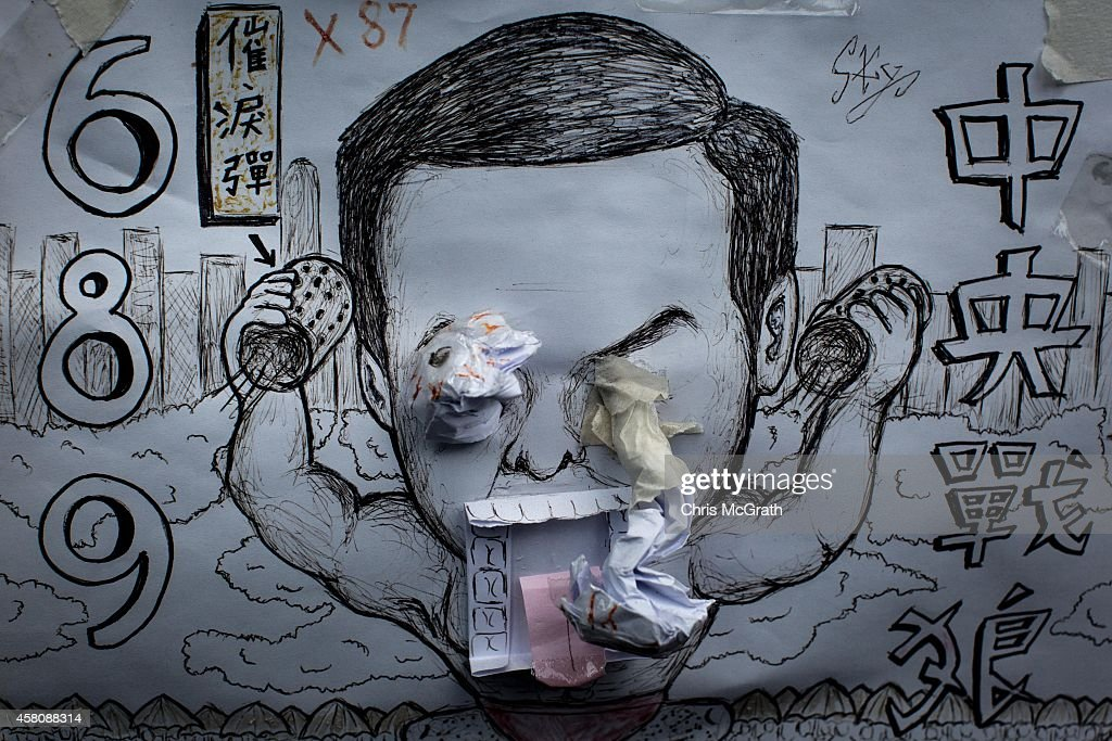 A poster showing Hong Kong's Chief Executive CY Leung is seen on a wall at the Occupy Central protest site in the Admiralty District on October 29...