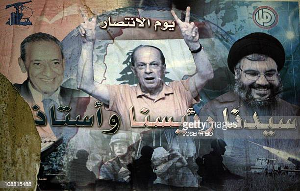 A poster showing Lebanese opposition leaders Parliament Speaker Nabih Berri Christian Free Patriotic Movement and MP Michel Aoun and Hezbollah...