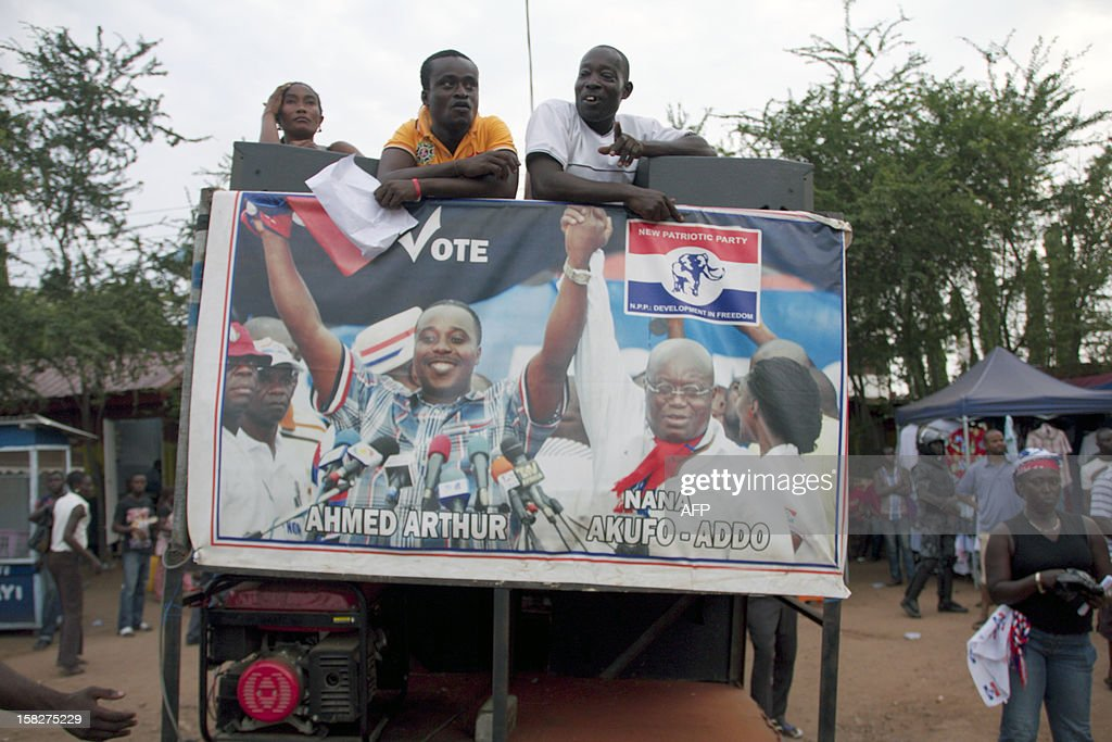 A poster shows opposition New Patriotic Party presidential candidate Nana AkufoAddo and parliamentarianelect Ahmed Arthur on December 12 in Accra...