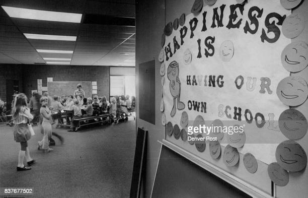 Poster Speaks for Students Attending New Vista Grande School Students in background study of cafeteria tables borrowed from other schools because the...