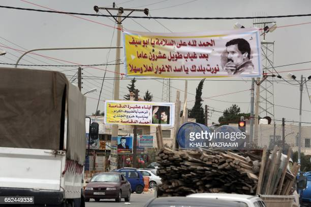A poster welcoming Ahmad Dakamseh is seen erected above a street in Irbid 90 kilometres north of the capital Amman on March 12 upon Ahmad's release...