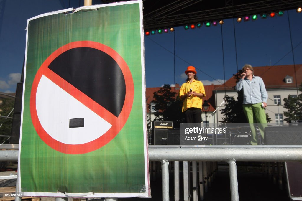 A poster with an anti-Hitler illustration hangs at a demonstration against the German far-right Nationaldemokratische Partei Deutschlands - Die Volksunion (National Democratic Party, NPD), on August 11, 2012 in Pasewalk, Germany. The counter-demonstration took place near the 'Pressefest' summer festival by the German far-right Nationaldemokratische Partei Deutschlands - Die Volksunion (National Democratic Party, NPD) , organized by the party's publication, the 'Deutsche Stimme' (the German Voice). The events took place in the German state of Mecklenburg-Vorpommern, known as a stronghold for the NPD, where the party won over 30% of the votes in two districts in state elections in 2011. There have been two attempts to legally ban the right-wing group, in 2003 and 2011, after a neo-Nazi terrorist cell murdered at least nine people of predominently Turkish background as well as one policewoman between 2000 and 2007.