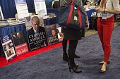 A poster with the cover of one of Republican Presidential hopeful Donald Trump's book is seen during the annual Conservative Political Action...