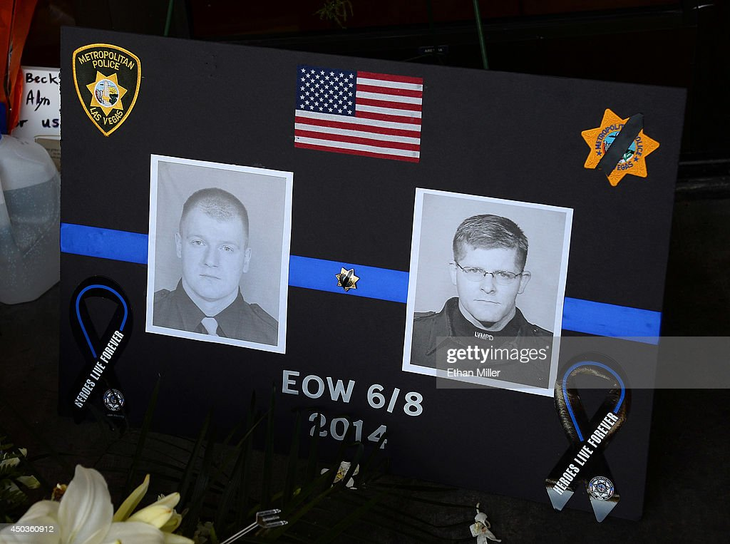 A poster with the images of the police officers that were killed is shown at a memorial at CiCi's Pizza during a vigil outside the restaurant on June 9, 2014 in Las Vegas, Nevada. The Las Vegas Metropolitan Police Department says officers Alyn Beck and Igor Soldo were shot and killed yesterday at the restaurant by Jerad Miller and his wife Amanda Miller. Police say the Millers then went into a nearby Wal-Mart where Amanda Miller killed Joseph Wilcox before the Millers killed themselves.