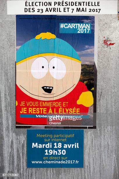 A poster with the South Park character Eric Cartman is fixed over the official poster of French presidential election candidate for the 'Solidarite...