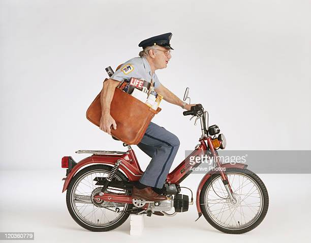 Poster worker delivering magazine on motorbike