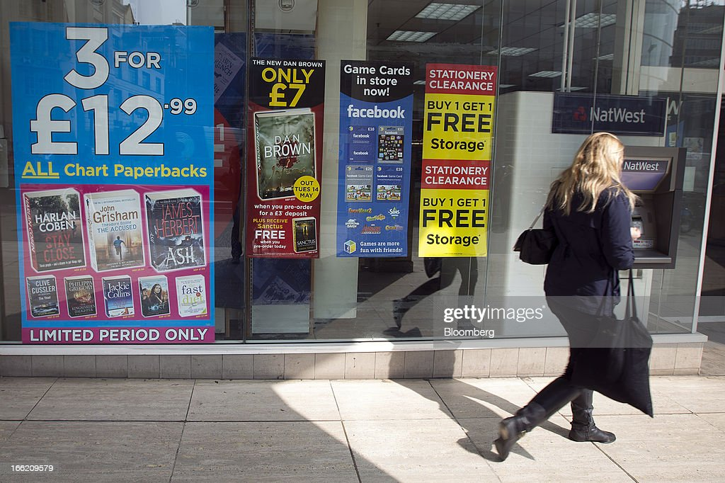 Posters advertise book offers, stationery deals and Facebook Inc. game cards available for sale in a WH Smith Plc store in London, U.K., on Wednesday, April 10, 2013. WH Smith Plc, the book and magazine retailer with more than 1,100 U.K. outlets, is scheduled to announce earnings on April 11. Photographer: Simon Dawson/Bloomberg via Getty Images