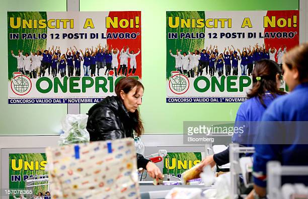 Posters advertising a 'job lottery' competition for one of 12 employment positions at a OnePrice supermarket operated by Gruppo BSE sit on a wall as...