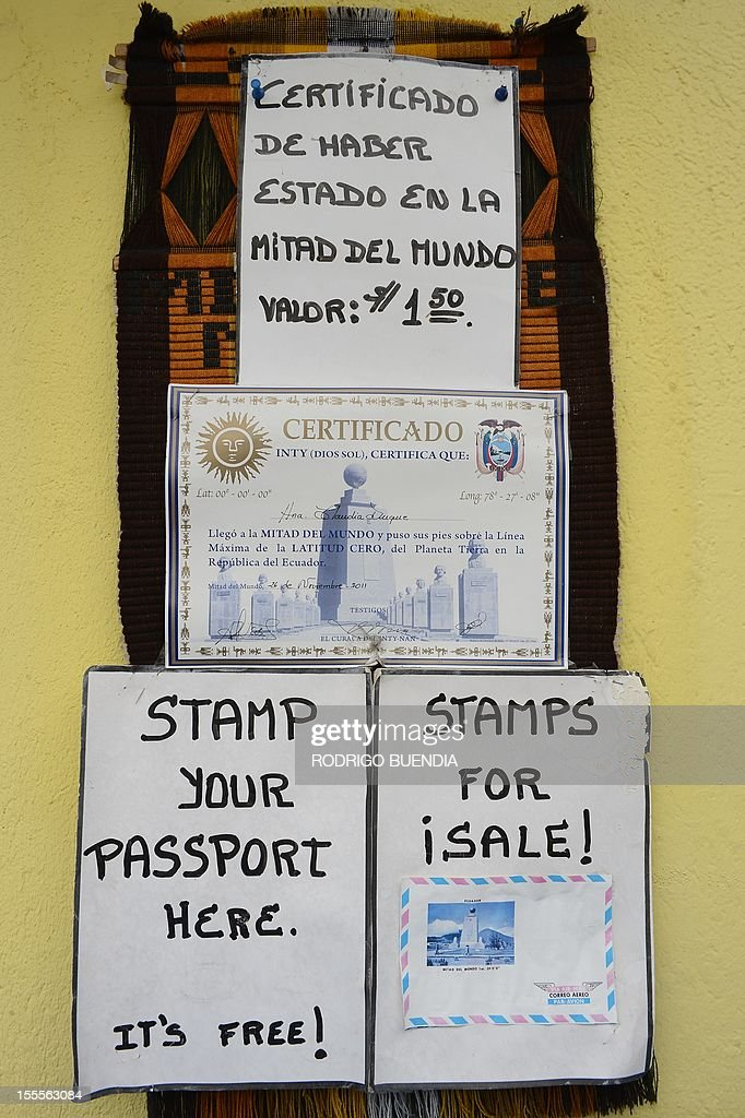 Posters advertising the certificate of having been in the 'Middle of the world' place, in Quito, Ecuador, on November 5, 2012. The world's tallest tower, 1.6 km, could be erected in Ecuador on the imaginary line that divides the world into two, a budding mega-project to honor the indigenous past and boost tourism, and it would take the mark of the Uruguayan architect Rafael Vinoly.