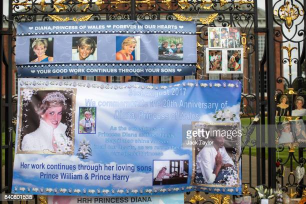 Posters and photographs sit on an entrance gate to Kensington Palace ahead of the 20th anniversary of the death of Diana Princess of Wales on August...