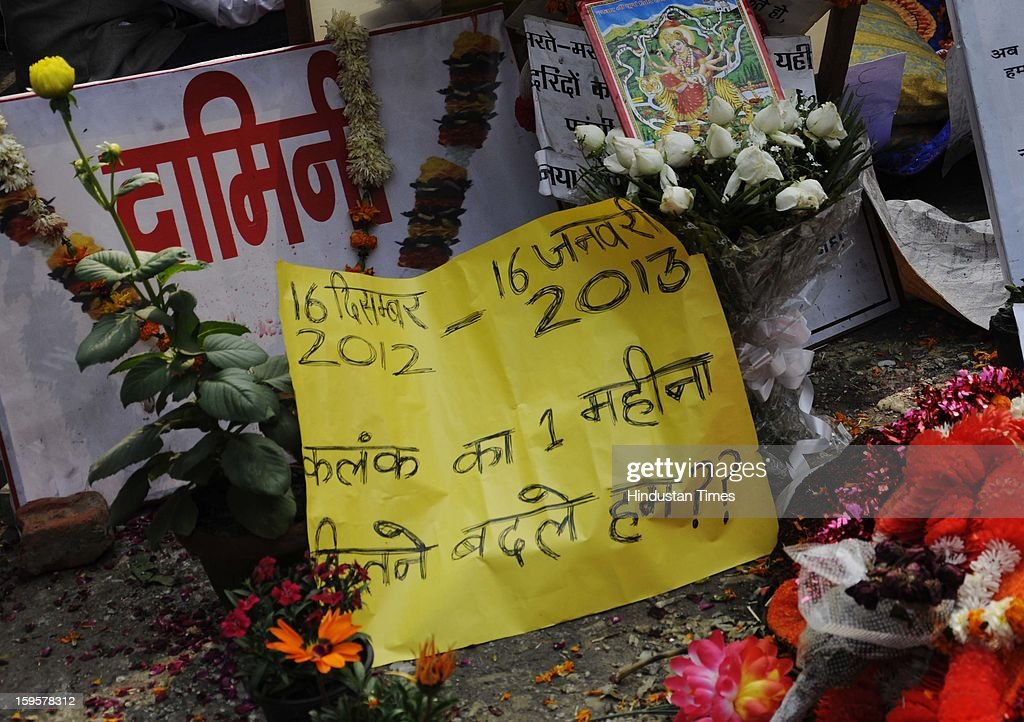 Posters are seen at the site of the protest against the alleged inaction by the Indian government regarding the gang rape of a 23-years old student in a bus a month ago, on January 16, 2013 in New Delhi, India. The bus rape has drawn protests and intense media attention. Rapes have become front-page news nearly every day across the country, with demands that police do more to protect women and that the courts treat sexual violence seriously.