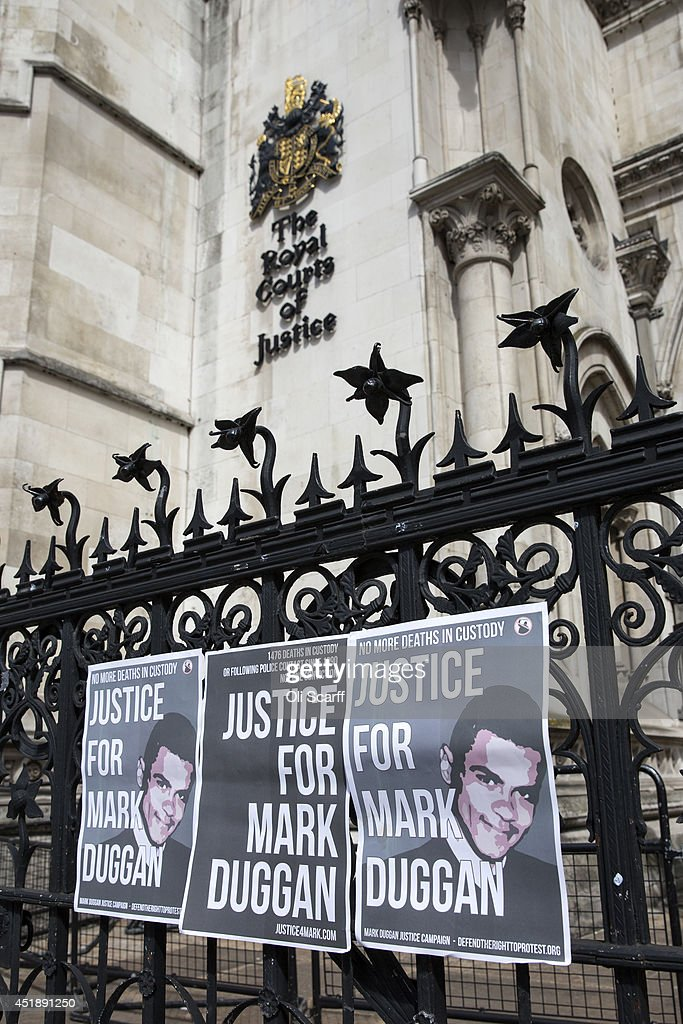 Posters campaigning for 'Justice for Mark Duggan' are placed on the railings outside the Royal Courts of Justice on July 9 2014 in London England...