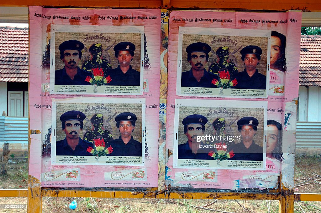 Posters commemorating the first man and woman Tamil Tigers suicide bombers displayed on Black Tiger day in Kilinochchi Sri Lanka