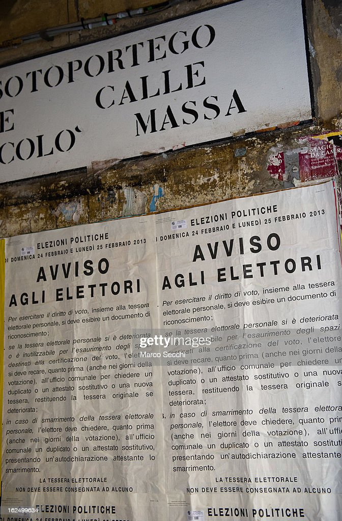Posters display voting instructions as the General Election gets underway on February 24, 2013 in Venice, Italy. Italians are heading to the polls today to vote in the elections, as the country remains in the grip of economic problems . Pier Luigi Bersani's centre-left alliance is believed to be a few points ahead of the centre-right bloc led by ex-Prime Minister Silvio Berlusconi.
