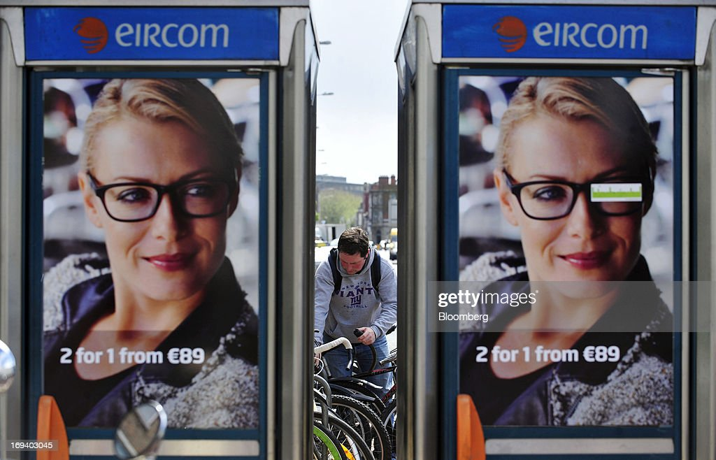 Posters for spectacle manufacturer Specsavers Optical Group Ltd. cover the windows of fixed-line public telephone booths, operated by Eircom Group, in Dublin, Ireland, on Thursday, May 23, 2013. Eircom Group, which has changed ownership six times since 1999, 'would like to be consolidators rather than consolidated' amid expected mergers and acquisitions in the Irish telecoms market, its Chief Financial Officer Richard Moat said. Photographer: Aidan Crawley/Bloomberg via Getty Images