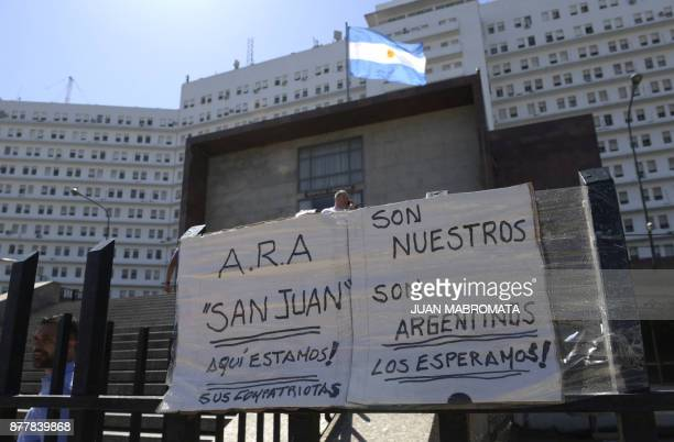 Posters giving strength to the submarine crew are seen outside Argentine Navy headquarters in Buenos Aires where Argentine Navy spokesman Captain...