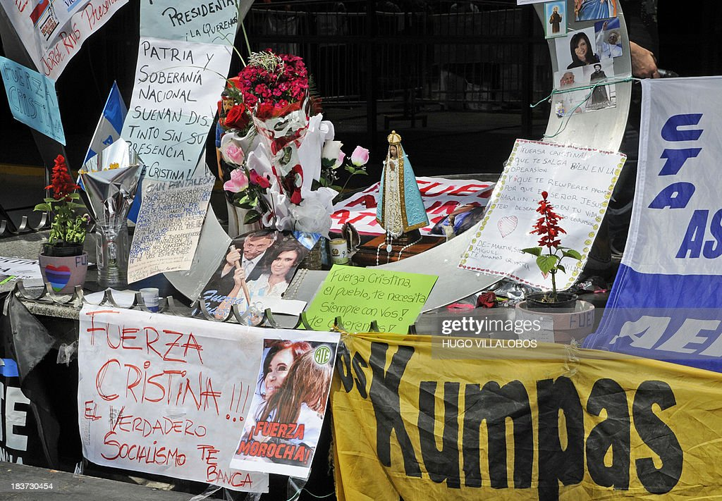 Posters, letters, pictures, statuettes, etc, in support of Argentine President Cristina Fernandez de Kirchner, are seen at the Favaloro Foundation in Buenos Aires on October 9, 2013. Cristina Kirchner was recovering 'without complications' Wednesday from surgery that successfully removed a blood clot on her brain, her doctors said. 'Her spirits are very good,' according to the medical report. AFP PHOTO / NA - Hugo Villalobos