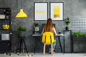 Posters mock-up interior with study space, desk, modern yellow chair