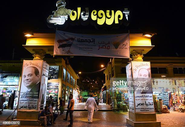 Posters of Egyptian President Abdel Fattah alSisi adorn a touristic market in the Red Sea resort of Sharm ElSheikh on November 10 2015 Usually...