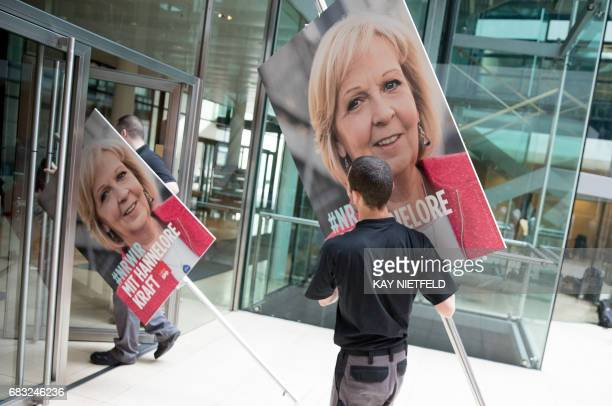Posters of Hannelore Kraft lead candidate of the Social Democratic Party for regional elections in the West German state of North RhineWestphalia are...