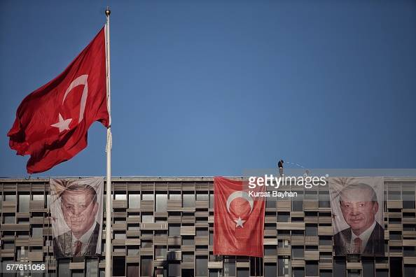 Posters of Turkey's President Recep Tayyip Erdogan and a Turkish flag hangs on Ataturk Cultural Center at Istanbul's central Taksim on July 19 2016...