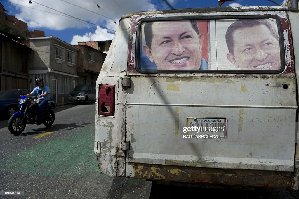Posters of Venezuelan President Hugo Chavez are seen in an old van in Caracas on January 4, 2013. Hugo Chavez's top aides have gone on the offensive, accusing the opposition and media of waging a 'psychological war,' as Venezuela's cancer-stricken president battles a serious lung infection. The closing of ranks followed a high-level gathering of top Venezuelan officials in Havana with Chavez, amid growing demands to know whether he will be fit on January 10 to take the oath of office for another six-year-term. AFP PHOTO/Raul ARBOLEDA
