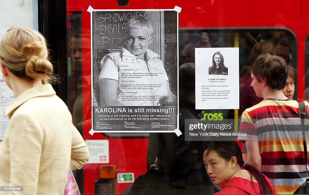 Posters on a London bus shelter on Euston Road plead for help in finding people missing after terrorists bombed three London Underground trains and a...