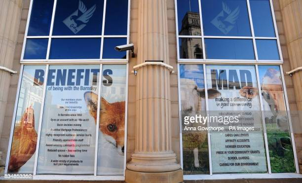 Posters on display in the window of the Barnsley Building Society Permanent Building in Regent Street Barnsley