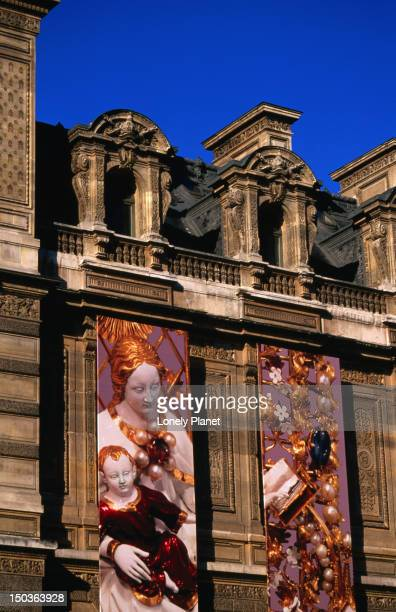 Posters outside Louvre.